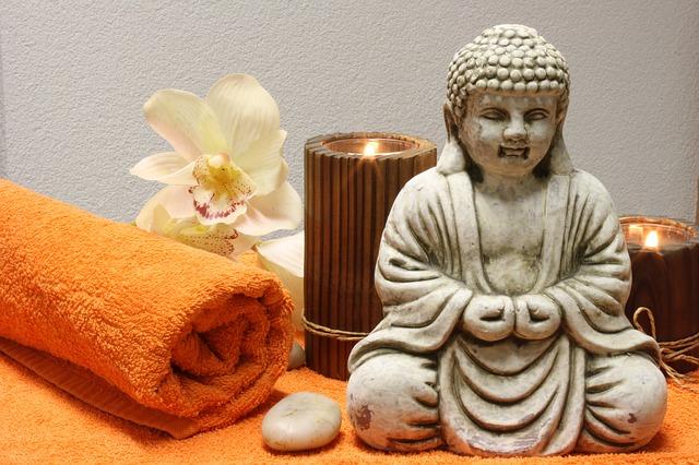 buddha, svíčky, ručník